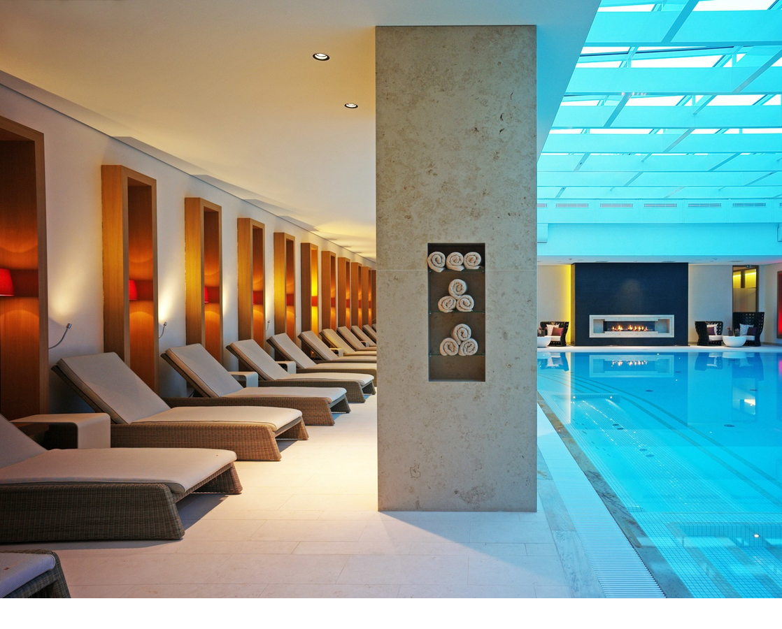 Swimming pool and relaxation area and swimming pool with natural light in the Hotel Severin*s Resort and Spa on Sylt